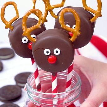 Chocolate Covered Oreo Reindeer Cookies are an adorable Holiday treat for kids and big kids alike. Double stuffed Oreos dipped in melted chocolate, pretzel antlers, candy eyes, and red hot nose -they come alive as the face of reindeer to spread Holiday cheer. #christmastreats #oreo #reindeer #christmasfood #easydessert #dessert #christmas #rudolph #nobake #holidayparty #christmasparty