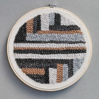 Another set of stripes, in greys, brown and black , including my favourite metallic fibres. Made with an #oxfordpunchneedle yarn and fabric, framed in a 10 inch embroidery hoop.⠀ #rughooking #tapestry #punchneedleembroidery #yarnlove #fibreart #punchneedle #textileartist #modernembroidery #textiledesign #contemporaryembroidery #hookedrug #wallhanging - Yellow Table Studio (@yellowtablestudio) on Instagram