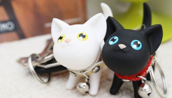 d5873f2ecb front view of cute black white cat keychain key ring chain