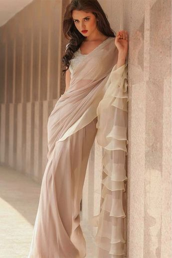 45a4063904bfc8 Georgette Ruffle Saree In Cream Colour