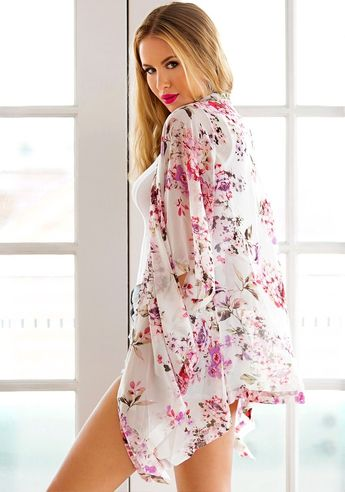 (sp) Enjoy summer even more with this white floral chiffon kimono. This is the perfect piece to wear if you plan to attend music festivals this summer.