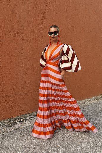 Seeing stripes // Blair Eadie wearing a striped dress and bolero, both by Johanna Ortiz // Sunglasses by Carolina Herrera and earrings by Dinosaur Designs