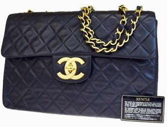Chic, elegant, large-sized bag; classic, iconic Chanel model with a double, gold coloured chain strap alternated with a tone-on-tone leather strip, flat mechanical clasp with double 'CC' logo.