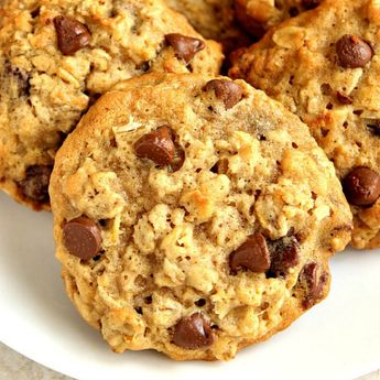 Oatmeal Chocolate Chip Cookies recipe – soft and chewy cookies with oats and chocolate chips. Thanks to melted butter, the dough is easy to stir up – no mixer needed! #cookies #oatmealcookies #dessert