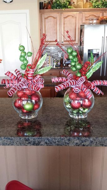 Red and white ribbons and colorful ornaments in empty jar.