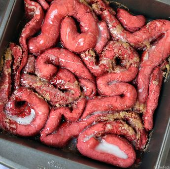 "They look gross...but taste delicious!! Red velvet cinnamon roll ""guts"" Halloween dessert - click ""make it"" for full recipe!"