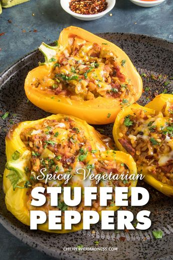 Spicy Vegetarian Stuffed Peppers - A vegetarian recipe for sweet bell peppers stuffed with spicy rice and cheese, baked, then topped with your favorite hot sauce. These are cheesy and hearty and just the right amount of spicy. Easy to freeze. #stuffedpeppers #vegetarian #peppers #stuffed #dinner