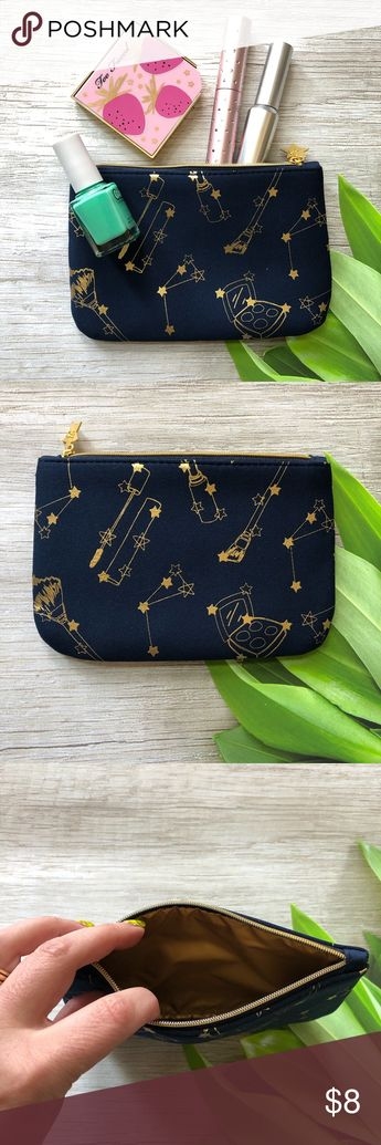 NWOT stars ⭐️ Constellations Makeup Bag NWOT Cute makeup bag that has room to hold plenty of your everyday essentials. Bag has gold foil stars, constellations and cosmetics adorning the outside. Perfect for that moon child you know.  Has a gold inner lining and a zip enclosure.   Perfect to use as a gift bag for the upcoming holidays or that little gift for someone.   Please ask questions and happy poshing Bags Cosmetic Bags & Cases