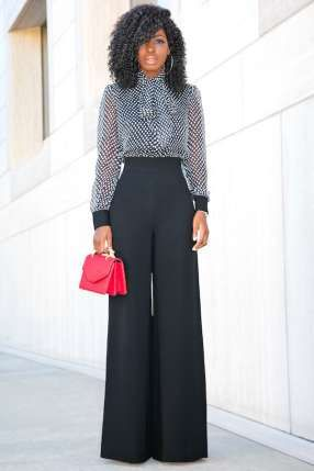 Style inspiration is taken from style blogger Folake Huntoon who is flawless in a junpsuit featuring sheer polka dot long sleeve top panel over wide leg bottoms that flatters her svelte figure.  She wore her signature big hair with the look  complete with soft smokey eye and  nude lips and gold loop earrings finishing the look with a colourful mini bag. What do you think of her cool jumpsuit look?