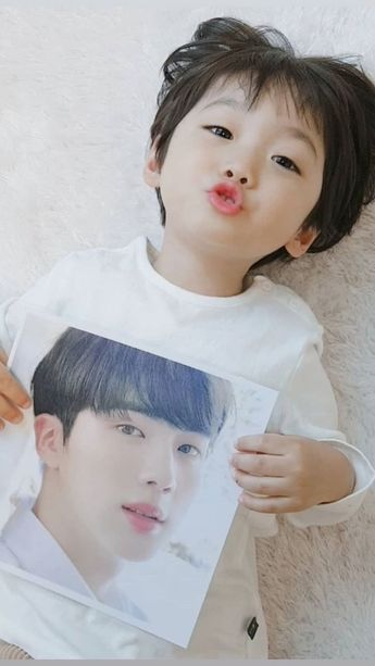 Awww he has the picture of Jin  follow this boy on instagram hes soooo cutee