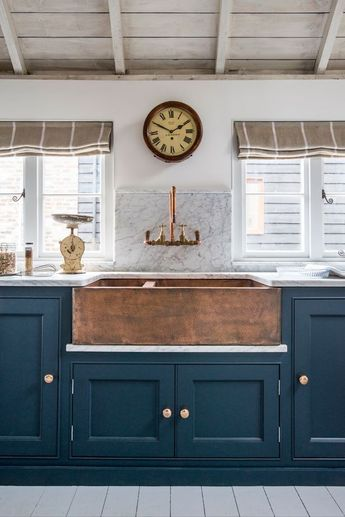Home Decor Inspiration : Dark teal cabinets combined with beige white and timber touches hint at a nauti
