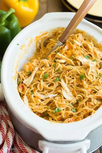 This Cheesy Crockpot Chicken Spaghetti is an easy crockpot meal for busy weeknights! It's made healthier with no canned soups, lean chicken breast and added veggies, and it cooks completely in the slow cooker for less clean up! Includes step by step recipe video. #crockpot #slowcooker #spaghetti #pasta #chicken #chickenrecipe