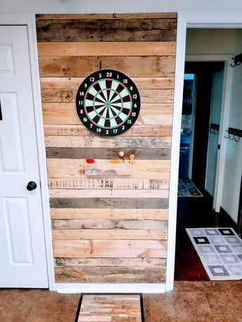 Fun pallet, dart board wall. Man cave decor.