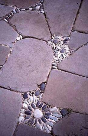 Riverstone mosaics between flagstones