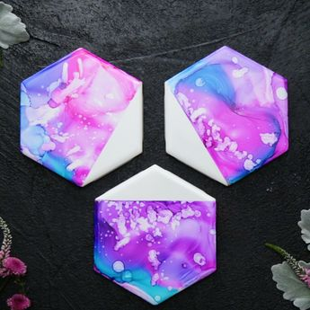 You can blame it on the alcohol ink, but these colorful coasters are giving off some serious vibes.