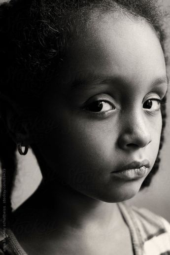 Portrait of young girl with a serious look on her face by anya brewley schultheiss