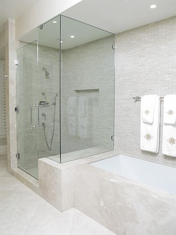 Once again, Susan Sager's design for the master bath meant that Jimmy Reed would again be using all natural stone materials to transform this once drab master bath into a luxurious space for relaxing in the tub or glass enclosed shower. The walls are natural marble mosaics and the natural stone was used for the entire tub surround and facing.