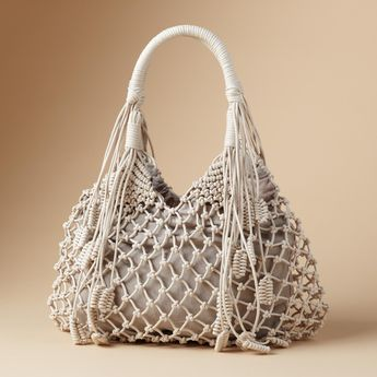 """STRING ALONG BAG -- Getting entangled can turn beautiful—with an artfully knotted bag full of bohemian spirit and worldly charm. Three interior pockets. Sturdy cotton/polyester lined. Imported. 17""""W x 14""""H."""