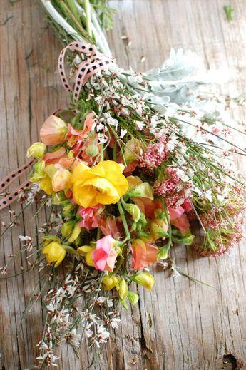 Rice Flower/Yarrow, Genestra/Wax Flower, Ranunculus/Garden Roses, Dusty Miller/Artemesia and Sweet Peas Bouquet as seen on mywedding.com from 'A Modern Wildflower Bouquet from Chelsea at Frolic!'