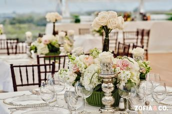 Romantic tablescape at an ocean front Nantucket wedding reception I Custom wedding paper by Nico and Lala