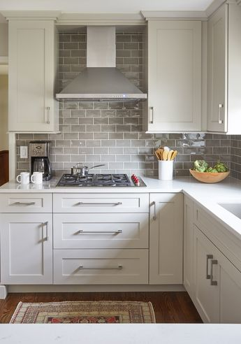 like white cupboards with neutral subway tile backsplash