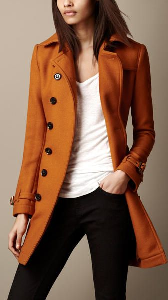 Who cares what your wearing when you top your look off with this Burnt Amber Midlength Trench by Burberry. A coat in a rich hue is a must-have this season!