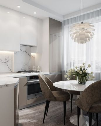 We LOVE this contemporary glass kitchen. Use our beautiful RAUVISIO crystal surfaces in your home: