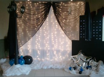 Masquerade : Photo Area with soft lights and simple balloon props with a bit of color
