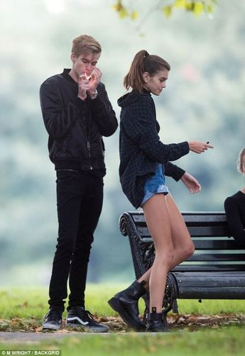Cindy Crawford's son Presley Gerber, 18, puffs away on a cigarette