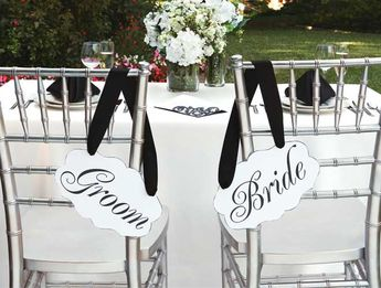 Give your wedding reception a touch of style with these fancy bride and groom signs. Add complementary ribbon to coordinate with your colors.