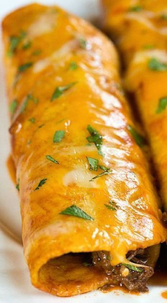 Beef Enchiladas Recipe ~ Wonderfully cheesy, saucy, and mildly spicy. If you love Mexican food you definitely need to add this to your weekly rotation! #beefenchiladarecipe #enchilada