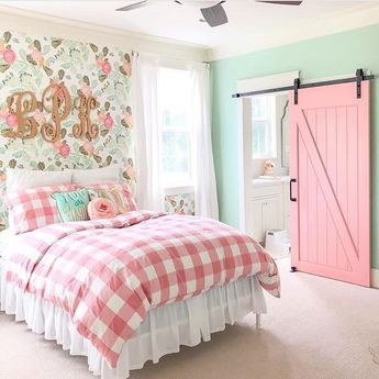 The pink sliding barn door is such a cute idea for a girls room.  Via @our_modern_antebellum