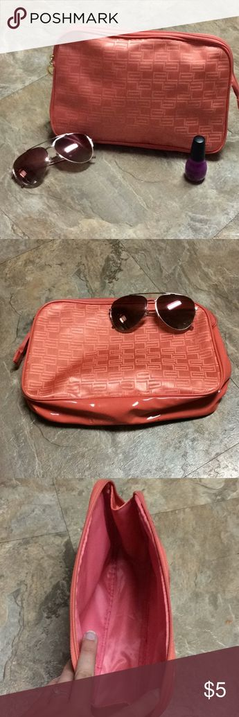 Coral colored Estée Lauder makeup bag Large barely used Estée Lauder makeup bag. No rips. In great condition.   **All accessories are for show only. They do not come with purchase** Estee Lauder Bags Cosmetic Bags & Cases