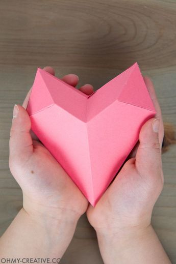 Learn how to make a 3D paper heart box for the perfect Valentine's Day gift idea. Fill these paper hearts with goodies for your special someone. #origamihearts