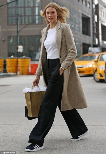 Off-duty Karlie Kloss inn wide-legged trousers and trainers