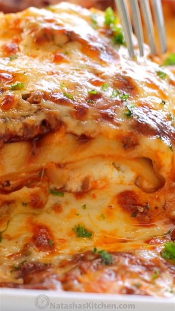 Our best Classic Lasagna Recipe that is supremely beefy, cheesy, saucy and so easy! Homemade lasagna is way better than any restaurant version. #lasagna #homemadelasagna #lasagnarecipe #pasta #casserole #dinner #video #videorecipe #lasagnavideo