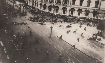 Russian troops firing on demonstrators with machine guns, corner of Nevsky Prospect and Sadovaya Street, St. Petersburg, 1917 [1042 × 633]