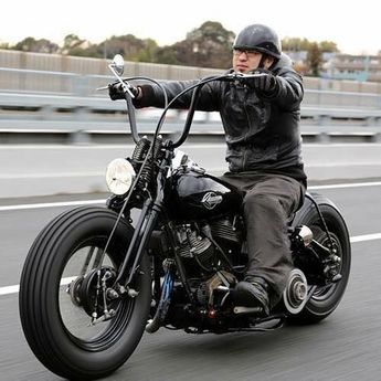 custom build Japanese Harley. in black with min apes on a springer.