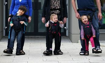 Harness invented by mother helps disabled children walk for first time