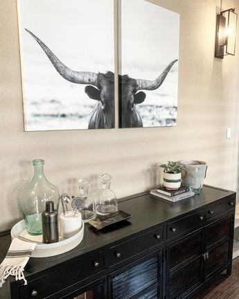 I love a good cocktail and I especially love a good bar space! The client requested a masculine bar area with a modern farmhouse feel. This metal cabinet and cow print plus the new sconces and fun bar styling all worked in unison to give him exactly what he wanted! . . . #bar #homebartender #cocktails #its5oclocksomewhere #pourmesomethingtallandstrong #masculine %