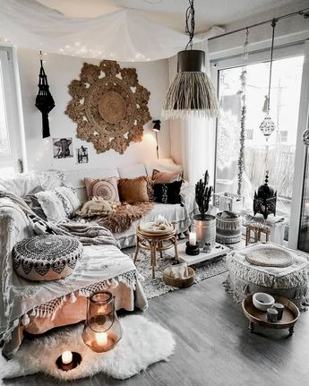 BLACK and WHITE BOHEMIAN living room. Elements (1) eclectic furnishings & decor (2) layered patterns & textures (3) beaded hangings (4) rugs - hung & on the floor (5) carefree overall look. #blackandwhite #boho #bohemian #livingroom #interiordesign