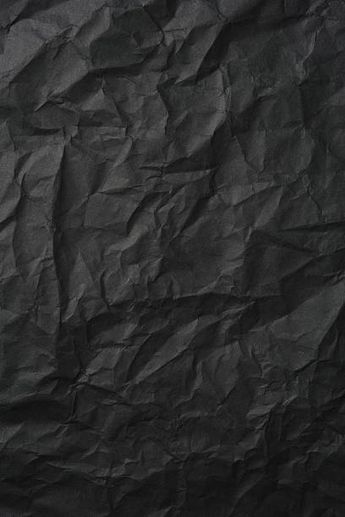 crumpled black rice paper background