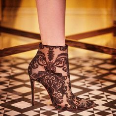 Christian Louboutin's 'Gipsy' boots are made from guipure lace that's sourced from the Northern French town of Caudry - a location known for its exquisite lace making