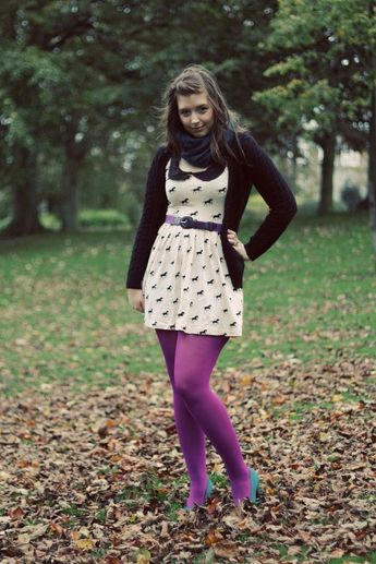 Kicking leaves in purple pantyhose and blue heels