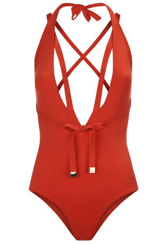A vibrant tango red swimsuit cut with a sharp, striking silhouette. The deep, plunging neckline stops just short of the waist for a supremely sensual look. Strap details highlight the décolletage and a soft belt accentuates the waistline. Adjustable halter-neck ties ensure a perfect fit. Slip on an elegant skirt to take this sophisticated swimsuit from poolside to cocktail party. #ad