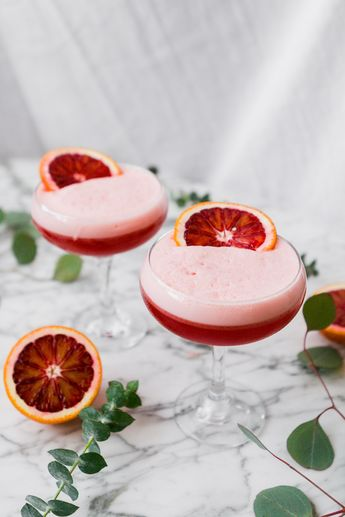 Gorgeously hued, incredibly easy to make, and flavored with blood orange juice and ginger liqueur, this Blood Orange and Ginger Boston Sour is one celebratory drink worth shaking up. | ChicChicFindings.etsy.com