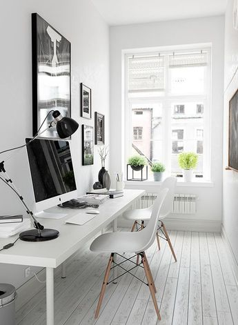 a modern and whitewashed office is made inviting with some modern pots