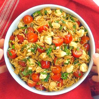 A vibrant salad loaded with juicy tomatoes, creamy balls of mozzarella, and ribbons of fresh basil! This Caprese Orzo Salad with Balsamic Vinaigrette is the best Orzo salad ever! Add this red and green recipe to your holiday menu list!