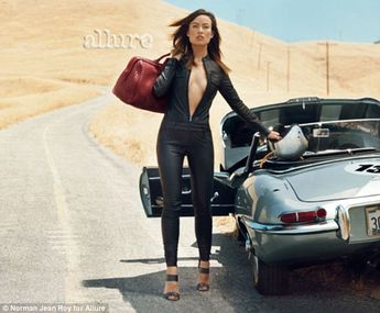 Leather-clad Olivia Wilde poses with a sports car.