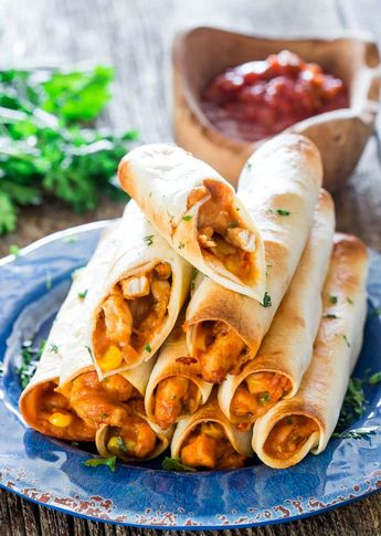 These yummy Chicken Taco Taquitos are baked but still cheesy and loaded with delicious goodness! Perfect for an appetizer, a snack or even lunch. #chicken #chickentaquitos #chickentacos